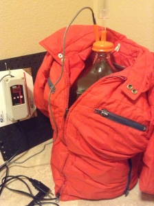 Carboy wrapped with an old down jacket